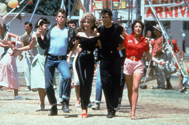 Sandy and the cast of Grease