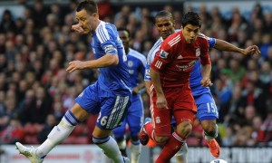 Luis Suarez of Liverpool and John Terry of Chelsea compete