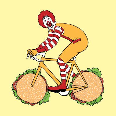 Ronald McDonald riding a bike with hamburger wheels