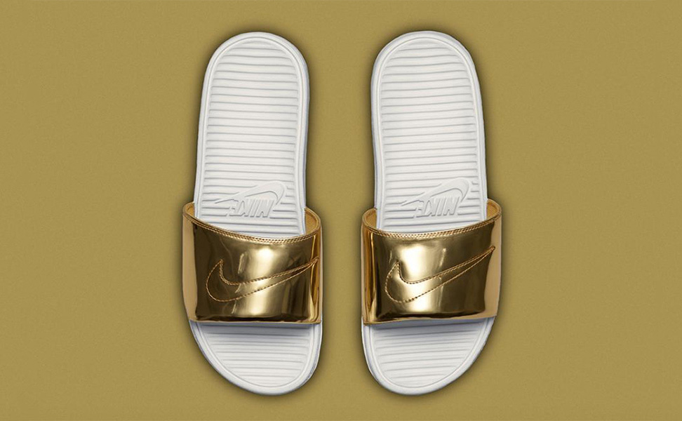 nike gold sliders